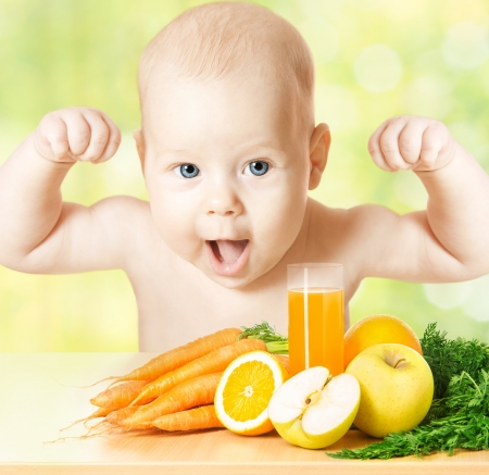 multivitamin: Baby with fresh fruit meal and juice glass Stock Photo