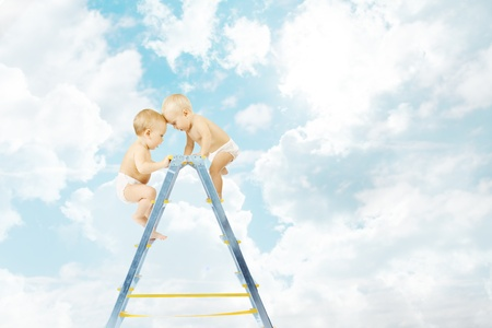 Baby climbing on stepladder and fighting  for first place over sky background  Competition concept photo