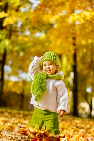 Happy child in autumn park photo