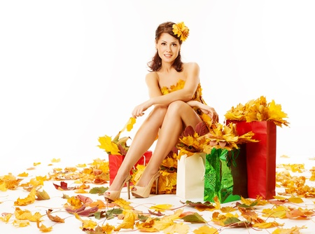 Autumn woman with shopping bags in dress of maple leaves. White background Stock Photo - 21716207