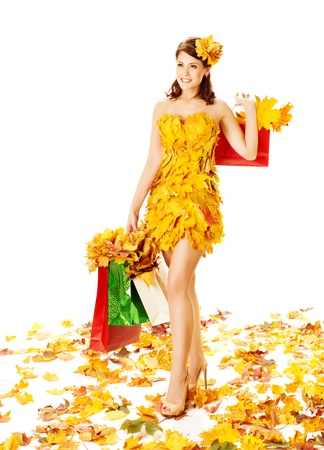 Autumn woman with shopping bags in dress of maple leaves. White background Stock Photo - 21736512