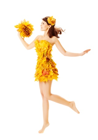 yellow dress: Autumn woman in fashion dress of maple leaves holding bouquet  leaves. Isolated