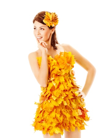 autumn young: Autumn woman in fashion dress of maple leaves holding bouquet of maple leaves. White background  Stock Photo