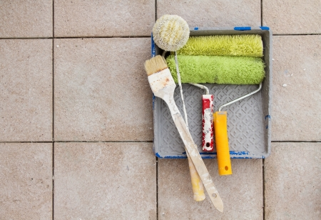 Repair tools over stone floor tile background. Copy space. photo