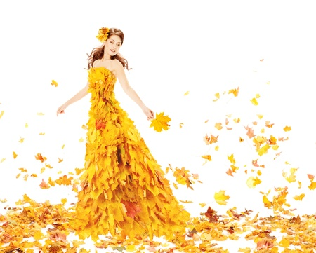 Autumn woman in fashion dress of maple leaves holding bouquet  leaves.  Stock Photo