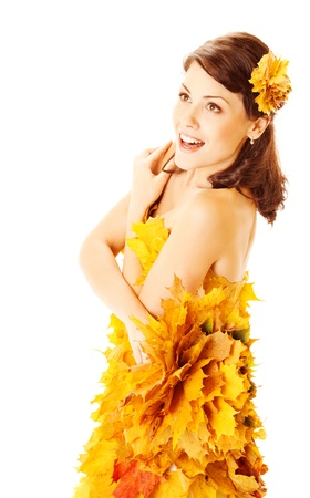 Autumn woman in fashion dress of maple leaves holding bouquet of maple leaves. White background  photo