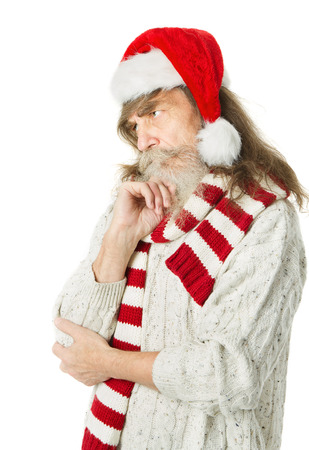 Thoughtful Christmas old man with beard in red hat, Santa Claus photo