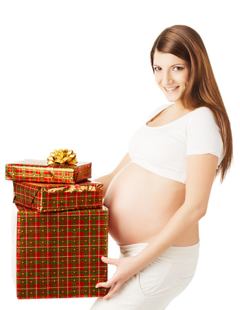 Pregnant woman holding present boxes. White isolated background  photo