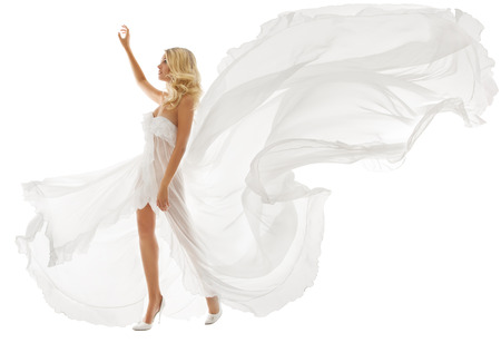 wind up: Beautiful woman in white dress with flying fabric walking over isolated background  Stock Photo