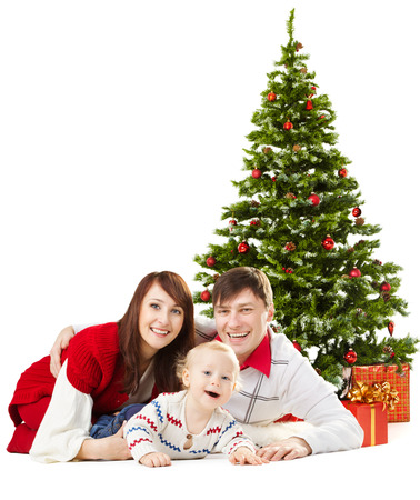 Christmas family funy baby lying under fir tree isolated over white background