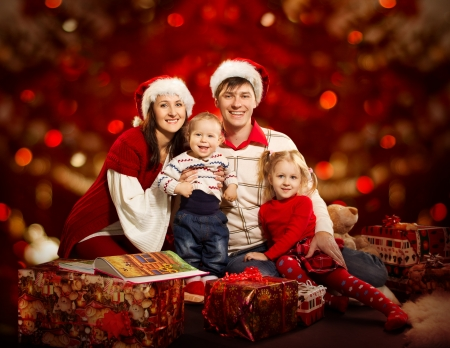 family holidays: Christmas family of four persons happy smiling