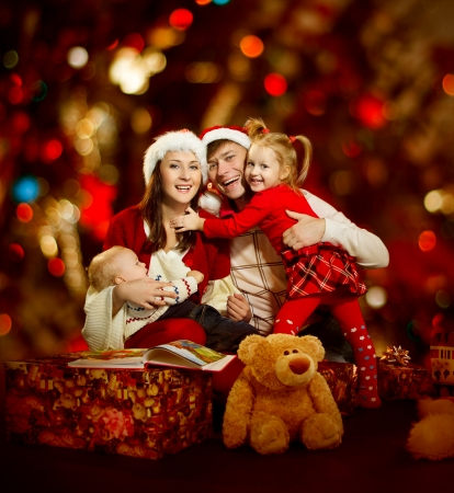 boy sitting: Christmas family of four persons happy smiling  Stock Photo