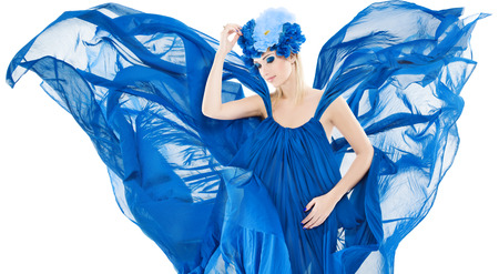 Woman in blue floral crown in chiffon waving dress, fabric fluttering wings over isolated white  photo