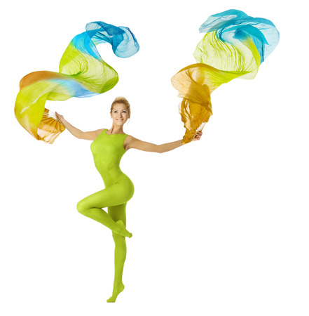 tiptoe: Woman dancing with flying colorful fabric. Sport and fitness beauty, isolated over white background  Stock Photo