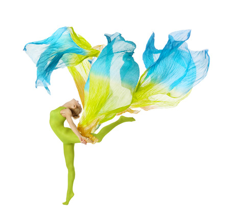 sport woman dancing with flying fluttering colorful fabric. fitness beuty isolated white background photo