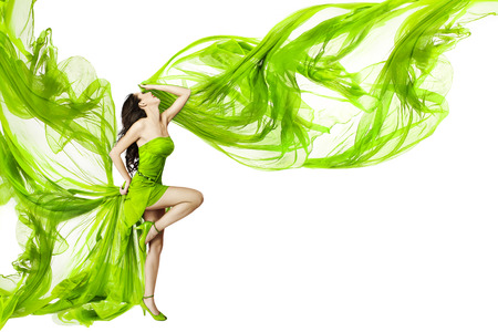 Woman dancing in green dress, beautiful fluttering and waving fabric, isolated white background