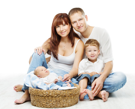 Young family four persons, smiling father mother and two children newborn sons, over white background  photo