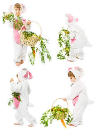 baby in easter bunny costume with fresh carrot basket, kid girl as hare rabbit over white background photo