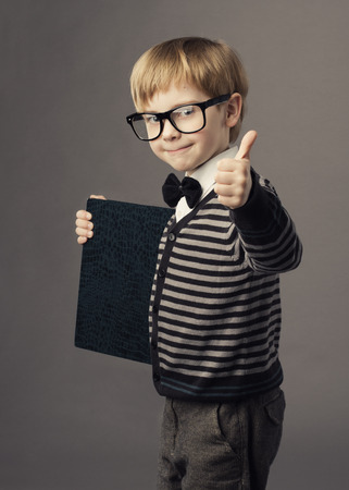 boy little smart child in glasses showing blank card certificate photo