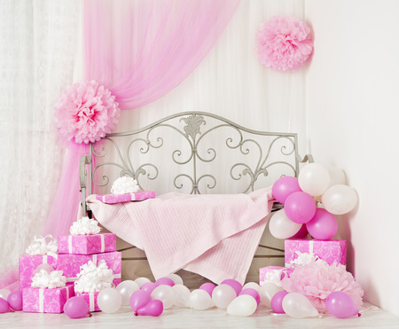 ballons: birthday party room background with gift boxes. Kids celebration presents girl or woman Stock Photo