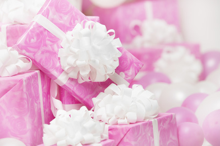 presents gift boxes, pink background for female or woman birthday photo