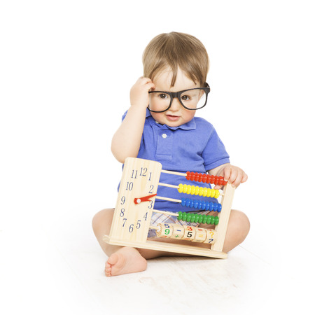 Boy child with abacus clock in glasses counting, smart little kid study lesson, education concept Stock Photo