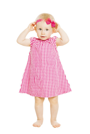 baby child: Little girl kid in red dress with bow. Child isolated on white background