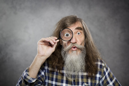 beard man: Senior old man looking through zoom magnifying glass  Funny elder amazement investigation or test vision loss