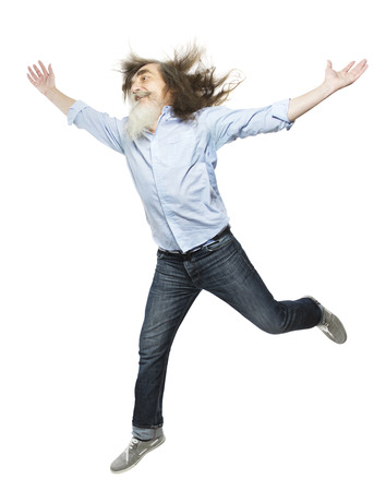 Senior jumping open arms, happy active elder. Healthy old man running isolated white background