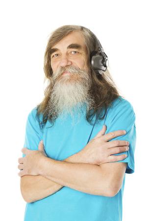 old man beard: Senior man listening to music in headphones. Old man with beard, elder isolated white background Stock Photo
