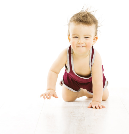 uncombed: Baby happy smiling with uncombed hairs, active tousled boy in sport suit crawling isolated over white background