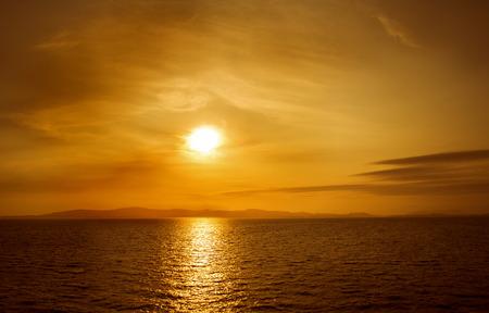 moonwalk: Sunset on sea. Bright sun on sky. Orange beach landscape