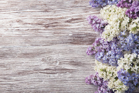 lilac flowers on wood background, blossom branch on vintage wooden texture