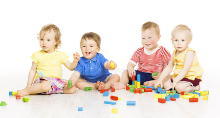Children group playing toy blocks  Baby Kids development, isolated over white background
