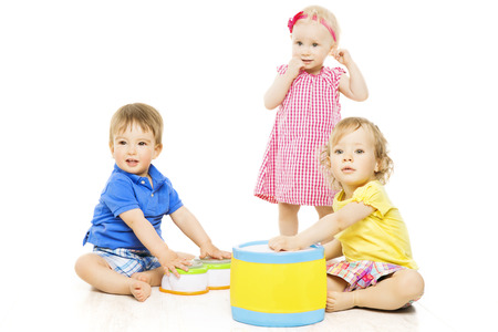 children playing with toys: Children playing toys  Small Kids and Baby development, isolated over white background