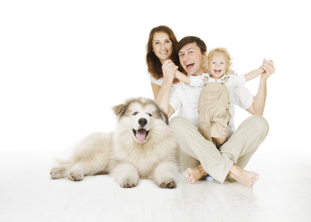 family and dog, happy smiling father mother and laughing baby child isolated over white background