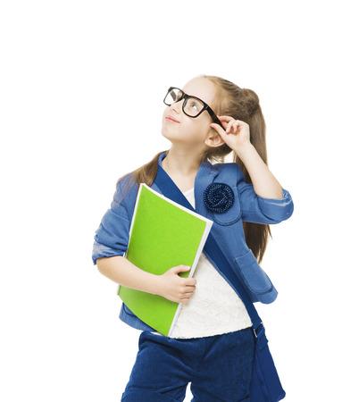 colegiala: Colegiala niño en vidrios con los libros mirando hacia arriba niña de la escuela del estudiante aislada fondo blanco Foto de archivo