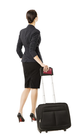back up: business woman back in airport, isolated over white, businesswoman in suit looking up, full length portrait