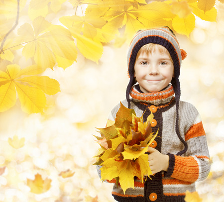 yellow fleece: autumn kid in leaves, little child in woolen hat, knitted clothing for October season