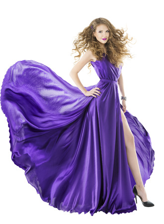 evening gowns: Woman silk dress, long fluttering train, girl purple fabric clothes with long hairs, isolated over white background