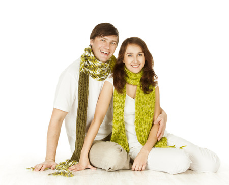 woman in love: Couple Portrait In Woolen Scarf, Isolated White Background. Young Man And Woman Love Happy Smiling And Embracing Stock Photo