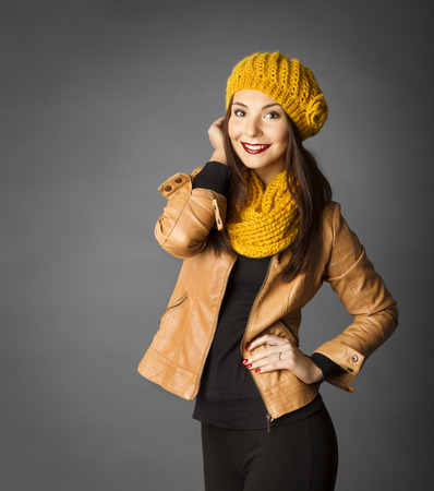 Woman Fashion Beauty Portrait, Model Girl In Autumn Season Clothing Posing in Studio, Yellow Fall Style over gray background photo