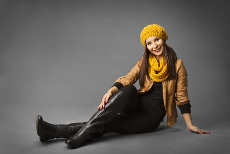 leather boots: Woman Fashion Beauty Portrait, Model Girl In Autumn Season Clothing Posing in Studio, Yellow Fall Style over gray background Stock Photo