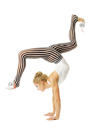 acrobat gymnast: Gymnast woman flexible body standing on arms, training stretching, isolated white background  Stock Photo