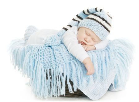 Baby Newborn Portrait, Boy Kid New Born Sleeping In Blue Hat, Child Isolated Over White Background photo