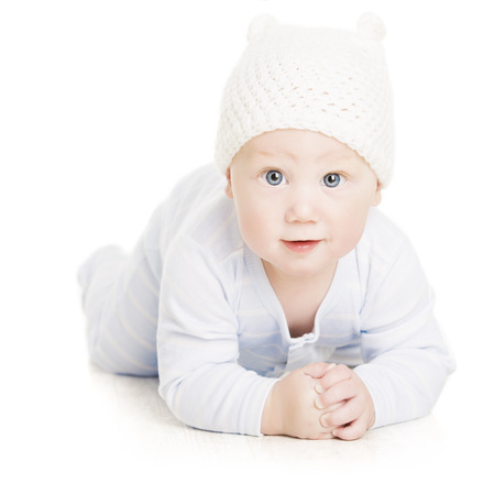 Baby Boy Portrait, Little Kid Crawling In Wolen Hat, Child Isolated Over White Background photo