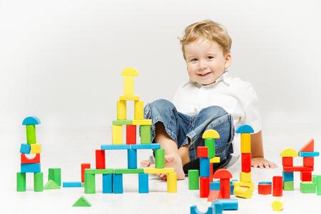 Child happy playing blocks over white photo