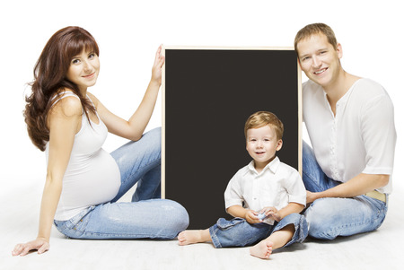 Family Advertising Blank Copyspace Board. Parents Education, Pregnant Mother Father And Child Portrait Over Isolated White Background Stock Photo