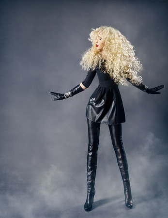 Woman Fashion Beauty Portrait, Model Girl Hairstyle with Blond Curly Hair, Beautiful Curls, Long Legs in Black Leather Leggings Boots photo