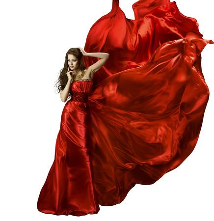 traje de gala: Mujer vestido de belleza Moda, Chica En Vestido elegante de seda roja que agita Tela, en el modelo de largo aleteo de tela en el viento, aislado sobre fondo blanco Foto de archivo